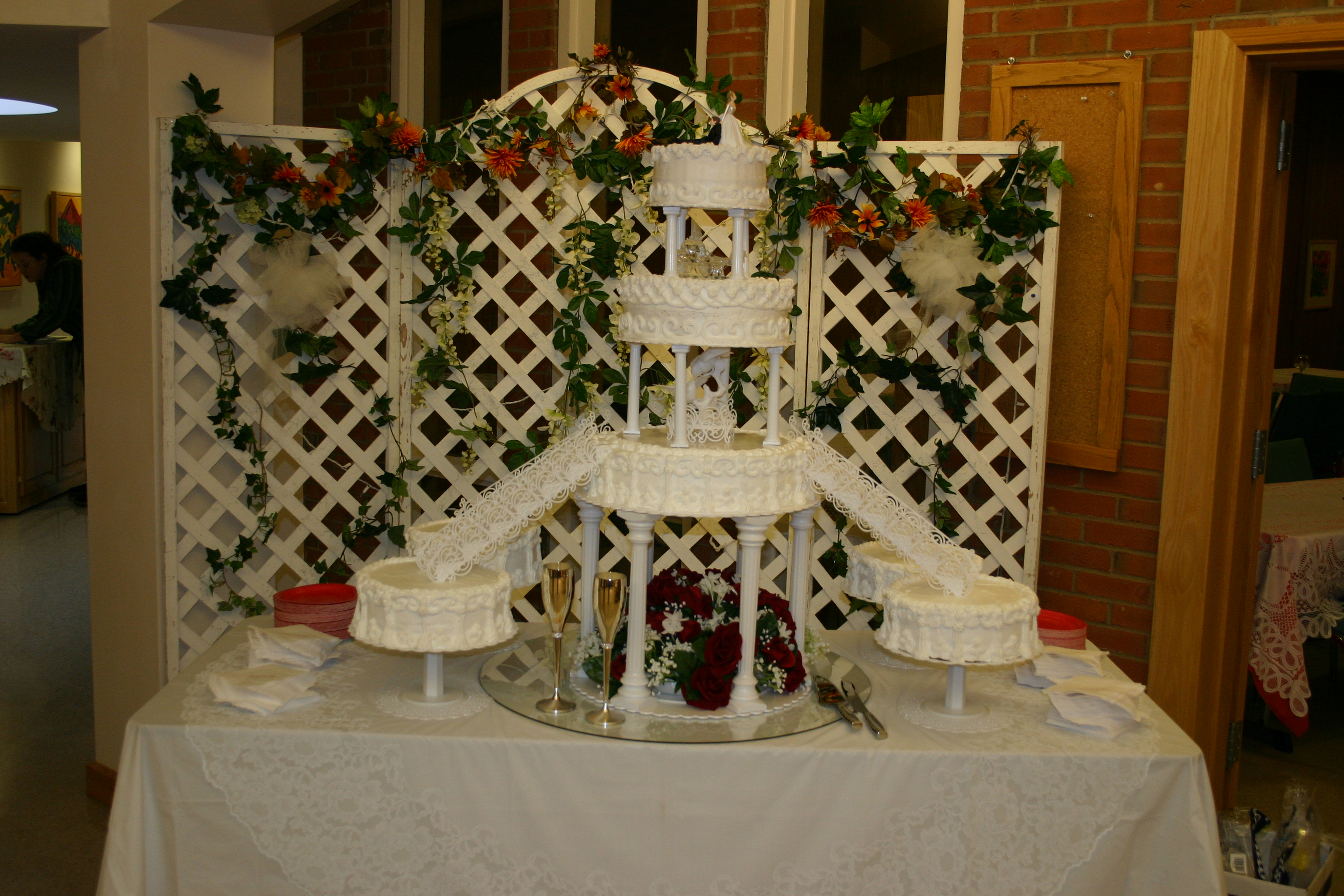 7 Tier round with satallite cakes and staircases